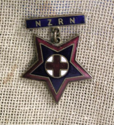 badge [1996.23.1.2]
