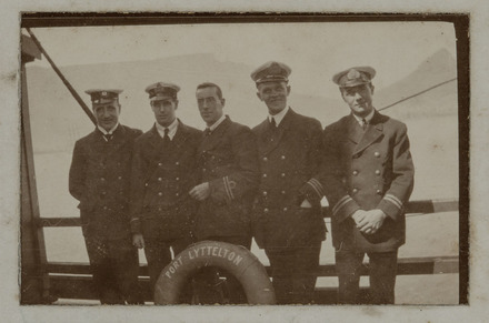 Unknown, photographer (1917). A few of us before church parade at Cape Town.  W. Simpitlaw 3rd engineer, F. Howell 5th engineer, R Needham 2nd mate, Alfred George Neall 1st Ref, P. Erson 2nd Ref. Auckland War Memorial Museum - Tamaki Paenga Hira. PH-ALB-461-p8-1. Image has no known copyright restrictions.
