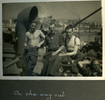 """Three men posing onboard transport ship, """"On the way out"""", Photo Album in Egypt of 638 Charles Honori Parks. Image kindly provided by Parks family. Image has no known copyright restrictions."""