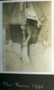 """Man emptying bucket from a makeshift shelter, """"The Rains 1940"""", Photo Album in Egypt of 638 Charles Honori Parks. Image kindly provided by Parks family. Image has no known copyright restrictions."""