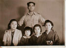 Portrait of Trooper Ngaro Komene 25911 with Japanese friends. Date unknown. Image kindly provided by Raymond Davison (January 2017). Image may be subject to copyright.