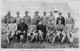 Officers at present in camp with the 8th New Zealand Contingent. Showing a group portrait of the officers at the 8th New Zealand Contingent's camp at Trentham, Hutt Valley, Wellington;(standing) Lieutenants Parker, Cotterill, Wighton, Simson, Langford, Taplin, O'Dowd, Pitt; (seated) Captain Davies, Lieutenant Gardiner, Captain Pringle, Captain Hughes, Captain Cameron, Lieutenant Haselden. Taken from the supplement to the Auckland Weekly News 16 January 1902 p001. Sir George Grey Special Collections, Auckland Libraries, AWNS-19020116-1-3. Image has no known copyright restrictions.