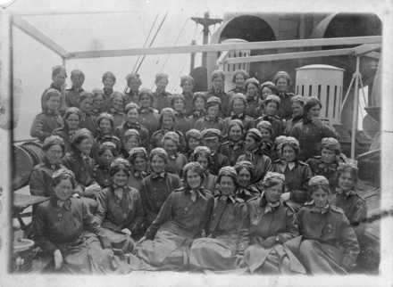 "New Zealand nurses on board the Rotorua, during World War I. Ref: PAColl-0321-001. Alexander Turnbull Library, Wellington, New Zealand. http://natlib.govt.nz/records/22881884. New Zealand nurses on board the Rotorua, during World War I. Sister Anderson is missing. Top row from left: Sisters Buckley, Wright, E J Harris, Nixon, Moore, Lowe, Siddells, Gibbon, Searell, Commons, Ingram. Next row: Sisters Scott, Mitchell, Fricker, Wilson, Curties, Davies, Sutherland, Samson, Chalmer, Cormack, Speedy, Dodds. 3rd row (standing): Sisters Bennett, Vida McLean, Young, Wilkie. 4th row: Sisters Foote, Crook, Livesay, Price, Edith Harris, Burke, Matron-in-chief Miss McLean, Clark, Nutsey, Captain Sutcliffe, Wilson, Matron Nurse, Butter, Bird, Pengelly, Stewart. Front: Sisters Inglis, Miller, McBeth, Smailes, Taylor (only face showing), Calder, Barnett. Taken by an unknown photographer on May 16 1915. Inscriptions: Verso - top centre - Group on boat deck of N.Z.S.S. Coup ""Rotorua"" May 16th 1915; Verso - centre - [Numbers corresponding to name list]; Verso - bottom centre - Nassau [illegible] / Miss Curtis, [illegible] Capt Denham, Nurse / [illegible], Nurse Davies - at Pyramids - June 26th 1915"