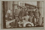 Unknown, photographer (ca.1917). Members of the 2nd Ref Eng and 5th Engs Club. E. Dane, F. Ewen, W. Simpitlaw, Holbeche, Donald, F. Howell 5th, P. Erson, A Neal 1st Ref. Boucher, C. George, Jack Wall, R Needham. Auckland War Memorial Museum - Tamaki Paenga Hira. PH-ALB-461-p3-2. Image has no known copyright restrictions.