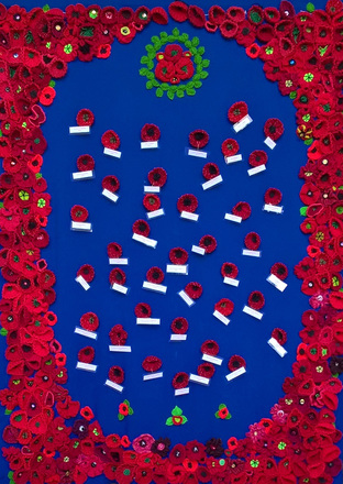 Memorial for the pupils of Onehunga Primary School, 1914-1918, with knitted poppies for each casualty. Created by the community of Onehunga and organised by the Onehunga Community House. Image provided by Bridget Graham, Onehunga Community Centre (February 2018). Image may be subject to copyright restrictions.