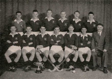 Group portrait of the Auckland Grammar School 1st XI Hockey team with John Bremner seated far right as coach. Auckland Grammar School Chronicle, XLII, 1954. Image is subject to copyright restrictions.