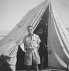 Photograph of 'wee Alec', Alexander Duthie Alexander 17006, in front of tent, possibly at Maadi Camp, c.Second World War. From the collection of Arthur William (Moss) Squire 16770, 23 Battalion. Image kindly provided by Roger Sommerville (September 2019). Image may be subject to copyright restrictions.