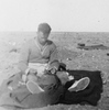 Photograph of Eric Batchelor mending his trousers, Western Desert, c.Second World War. From the collection of Arthur William (Moss) Squire 16770, 23 Battalion. Image kindly provided by Roger Sommerville (October 2019). Image may be subject to copyright restrictions.